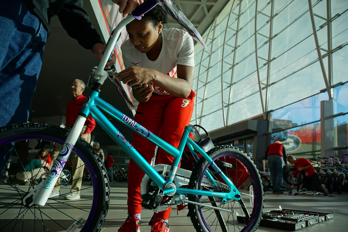 The Georgia women's basketball team joined members of the Fastbreak Club at Stegeman Coliseum to assemble bicycles for children on Monday. (Photo from Georgia Sports Communication)